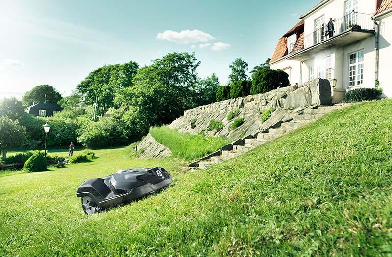 Husqvarna Automower 450x cutting grass on a slope